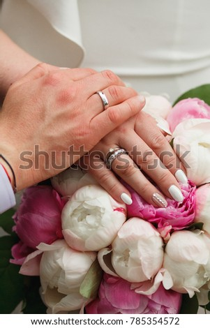 the bride and groom show the wedding rings #785354572