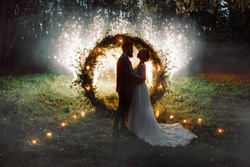 The bride and groom. The night by the light of fireworks.