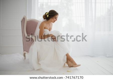 The bride is gathering in the morning.Stylish white wedding dress. The bride's shoes. #741767170