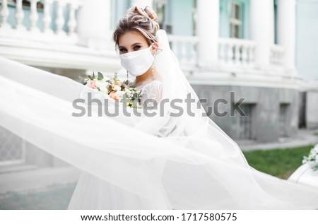 The bride of European appearance in a mask. Coronovirus Wedding