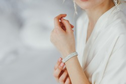 the bride wears a bracelet on hand