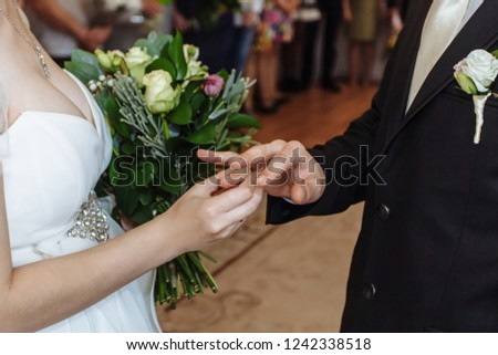 The bride wears a ring to the groom at the wedding ceremony. #1242338518