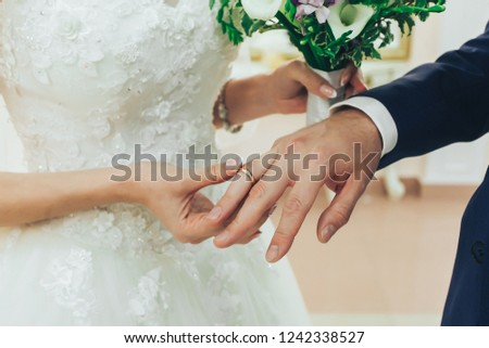 The bride wears a ring to the groom at the wedding ceremony. #1242338527
