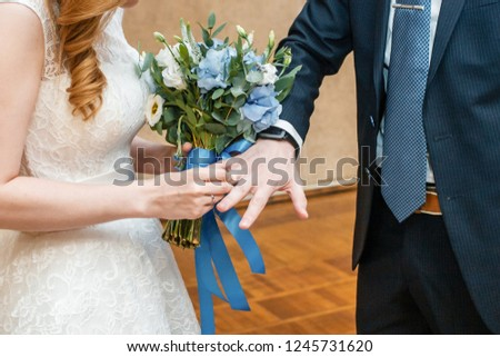 The bride wears a ring to the groom at the wedding ceremony. #1245731620