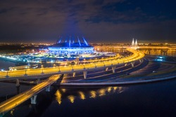 The bridge across the strait. The Gulf of Finland. Saint Petersburg. Highway in the evening. Evening city. Russia. The road leading to the island. Krestovsky Island in St. Petersburg.