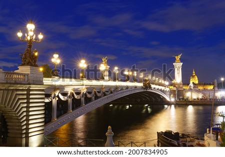 The bridge Alexandre III was offered to France by the Emperor Alexandre III of Russia to mark the Franco-Russian Alliance. It was inaugurated in 1900 at the Universal Exhibition. Paris. France. Stock photo ©
