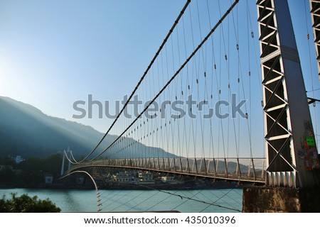 The bridge on river Ganges in small town, INDIA #435010396