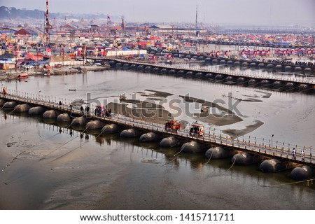 the bridges that pass over the holy ganges river and connect the parts of the huge tent city established for millions of pilgrims