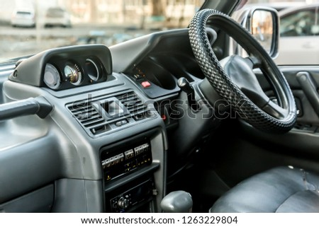The bright photo of the dashboard in the car with black salon #1263229804