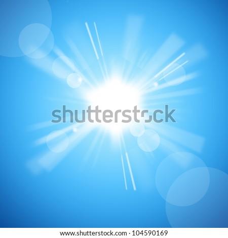 The bright white sun in the blue sky - stock photo