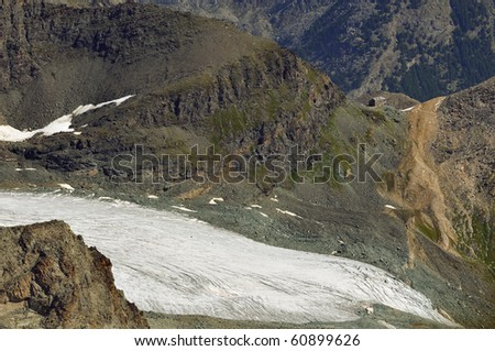 The Britannia hut perched on a ridge above a glacier, starting point for many high mountain climbs in the swiss alps near Zermatt