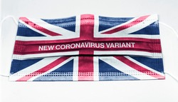 the british flag printed on a surgical mask with the indication of the new corona virus variant. Health and medicine. Global pandemic