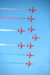 The British RAF Red Arrows display team performing with their Hawk trainers  July 2008.