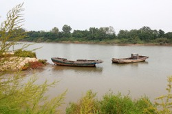 The broken fishing boat is in the river