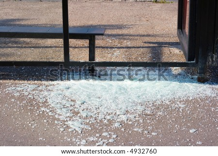 The broken glass at a bus stop