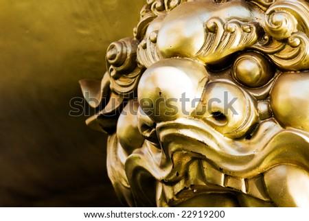 The bronze lion guardian China temple Chonburi Thailand