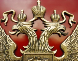 The bronze Russian railway mark on a red background