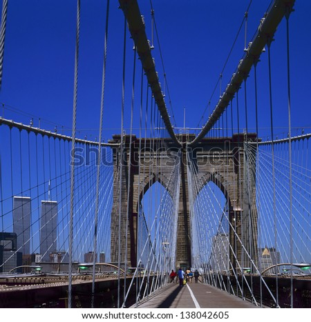 The Brooklyn Bridge offers great views of the Manhattan skyline. This photo has been taken before 9/11 so at the left side you see the twin towers of the World Trade Center