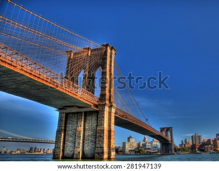 The Brooklyn Bridge over East River viewed from New York City in HDR #281947139