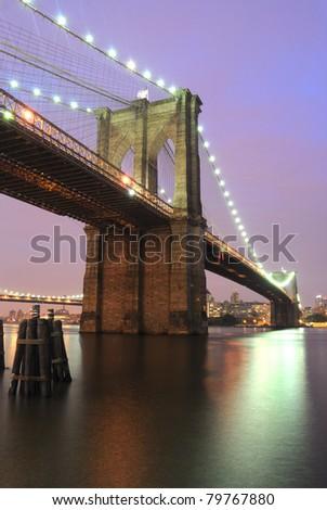 The Brooklyn Bridge shimmering at night.