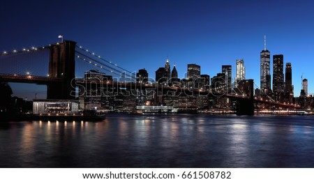 The Brooklyn Bridge, which is deepening by night.