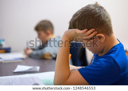 The brothers do their boring homework homework.