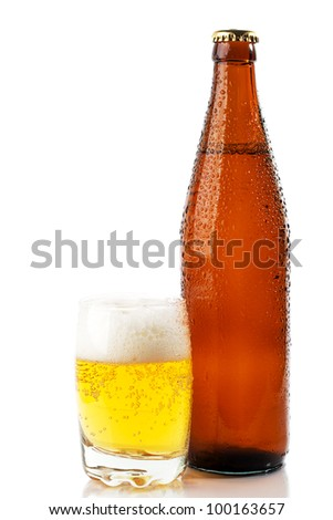 The brown bottle of beer and a glass of beer on white background