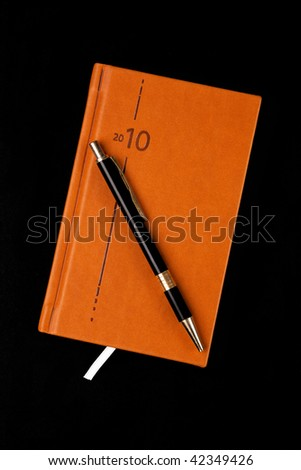 the brown diary and pen