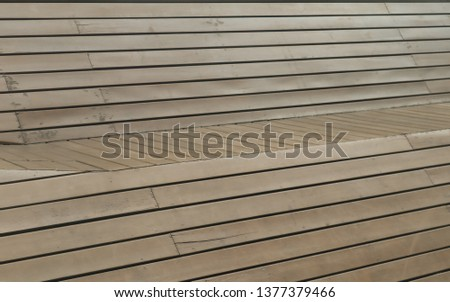 The brown old wooden panel set as the retro exterior decoration. Wallpaper image. Background image. Abstract image.