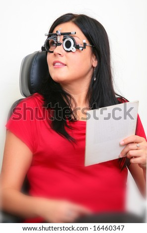 the brunette on the sight-testing - stock photo
