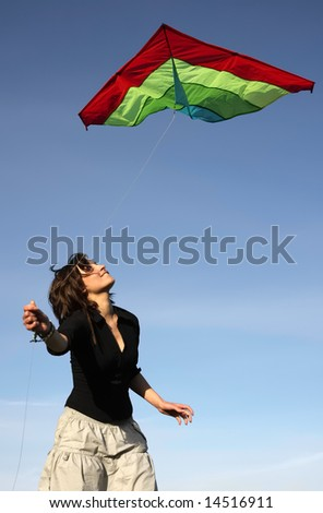 the brunette starts the snake, on a background of the blue sky