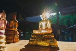 The Buddha statue is made of transparent glass
