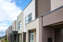 The building of a row of residential modern townhouses in an Australian suburb. Some suburban homes in Melbourne, VIC Australia.