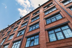 The building of the former factory of red brick, redone for offices, loft style