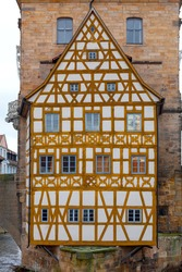 The building of the old medieval town hall on the bridge over the river at dawn. Bamberg. Bavaria Germany.