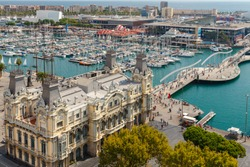 The building of the port and the boats in the harbor of Barcelona.