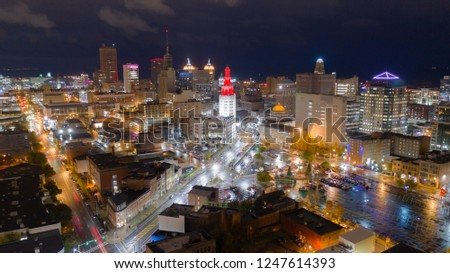 The buildings are illuminated before sunrise in the urban core of Buffalo New York