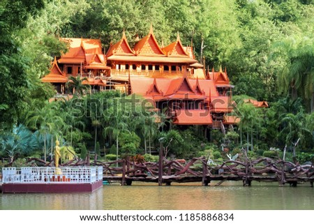 The buildings within the temple of Thailand are many trees and the mountains are the background. Public Attractions in Thailand. Khao Wong Temple in Uthai Thani in Thailand. #1185886834