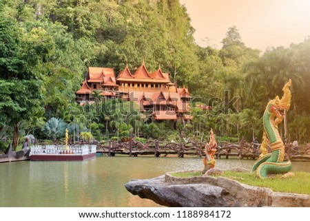 The buildings within the temple of Thailand are many trees and the mountains are the background. Public Attractions in Thailand. Khao Wong Temple in Uthai Thani in Thailand. Flare. #1188984172