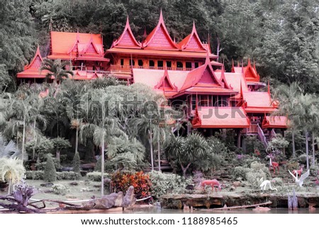 The buildings within the temple of Thailand are many trees and the mountains are the background. Public Attractions in Thailand. Khao Wong Temple in Uthai Thani in Thailand.Make a difference of color. #1188985465