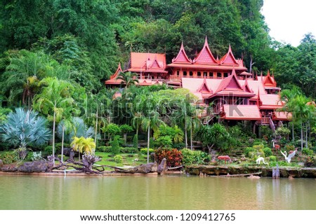 The buildings within the temple of Thailand are many trees and the mountains are the background. Public Attractions in Thailand. Khao Wong Temple in Uthai Thani in Thailand. #1209412765