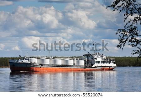 The bulk-oil vessel transporting cargo on the river Ob, Russia, Siberia