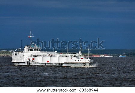 The bulk-oil vessel transporting cargo on the river Ob, Russia, Siberia