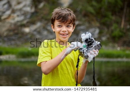 The bully ruined him fathers camera by wetting it. A cheerful child ruined the camera of his parents.