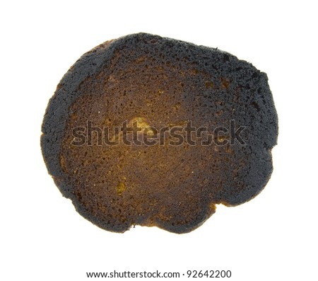 The burned back of a peanut butter cookie.