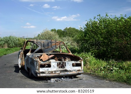 The burned down automobile on earth road