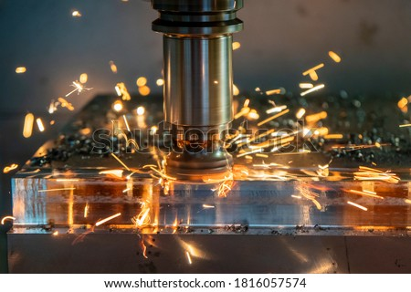 Photo of  The burning chip from CNC milling machine rough cutting  by index-able  end-mill tools. The index-able tool wear from machining center.