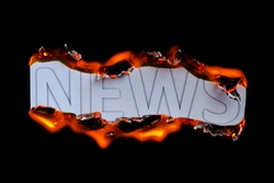 The burning news caption is isolated on a black background. The concept of hot news. Hot News In Flame Text