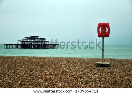 The burnt down Brighton Pier on the bank of the English Channel in Brighton, England