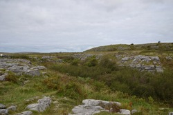 The Burren is a region of County Clare in the southwest of Ireland. the landscape is made of glacial-era limestone, with cliffs and caves, fossils, rock formations